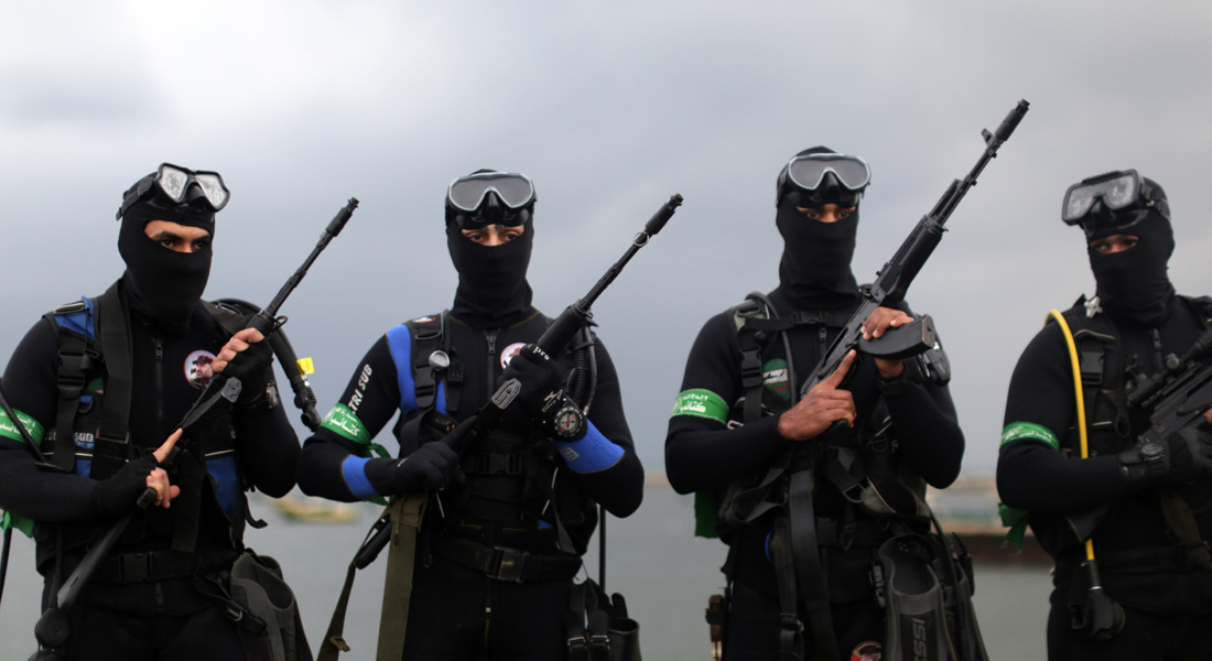 Palestinian Frogmen of the Ezzedine al-Qassam Brigades, Hamas's armed wing, pose in wetsuits as they take part in a military parade marking the 27th anniversary of the Islamist movements creation on December 14, 2014 in Gaza City. AFP PHOTO / MAHMUD HAMS (Photo credit should read MAHMUD HAMS/AFP/Getty Images)